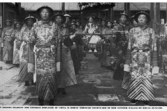 "Eunuchs of Qing dynasty before 1908.  The caption reads: ""In solemn majesty, the empress dowager Cixi of China is borne through courtyard of her Summer Palace by royal eunuchs"""